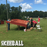 A group of people enjoying the skeeball area of Jaemor Farms